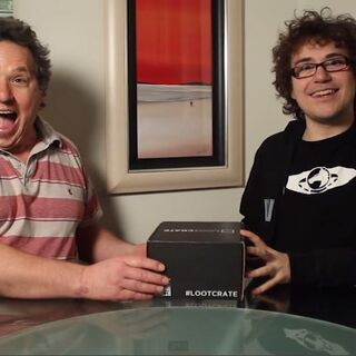 Dan's Dad or Dad3, opening a Lootcrate with his son.