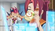 Yuma pulls a face behind his sister