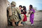 Sgt. Joshua Smith with Afghani kids