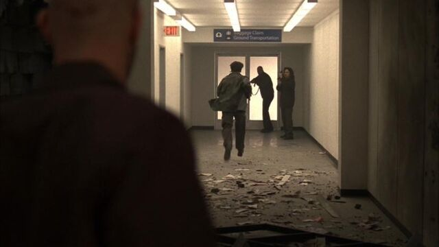 File:5x04-terrorists-down-hallway.jpg