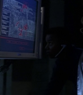File:3x24- CTU tech with headset working with Michelle Dessler.jpg
