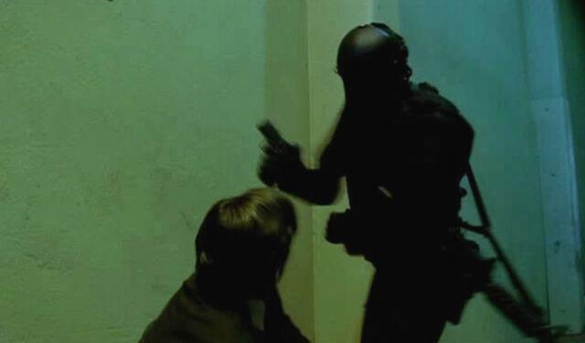 File:24- S8, Ep22- Logan's limo bodyguard KO'ed.jpg