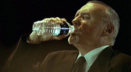 File:1x23 10-11PM Victor Drazen drinks refreshment.jpg