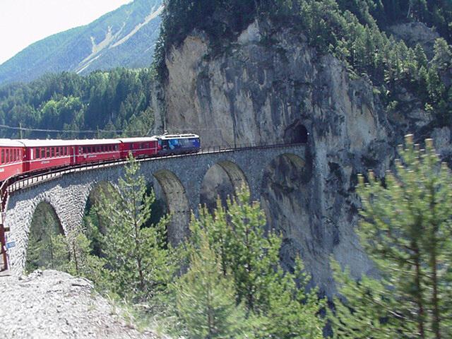 File:Swiss train entering tunnel.JPG