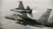 F-15E Strike Eagle and F-16C Fighting Falcon breaking