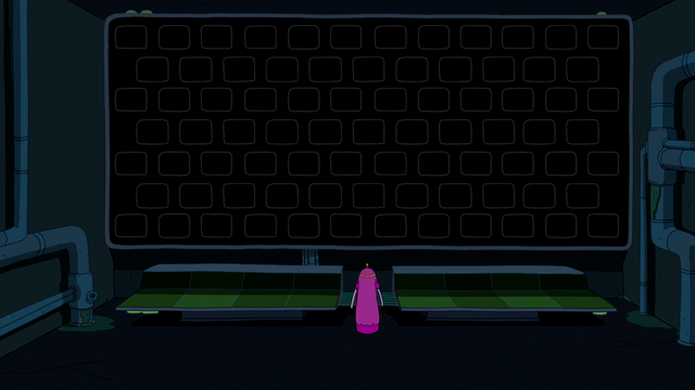 File:S6e22 PB standing in front of darkened screens.png