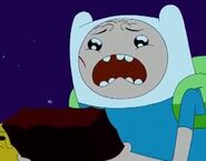 S4e26 scared Finn holding The Enchiridion