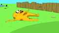 S5e27 Jake lying on grass.png