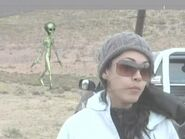 Alien In Back Ground News Show