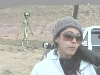 File:Alien In Back Ground News Show.jpg