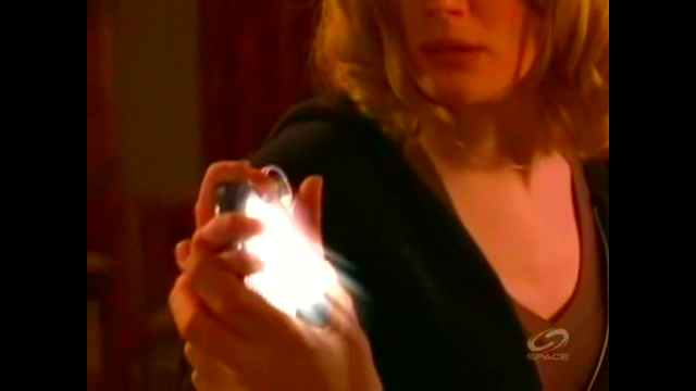 File:The Collector glowing in Mel's hand..png