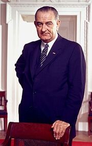 220px-Lyndon B Johnson, photo portrait, leaning on chair, color cropped