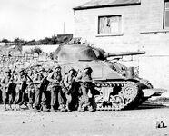 Yanks advance into a Belgian town