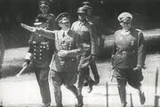 Hitler and men in 1938