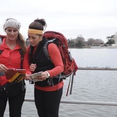 Mona & Beth reading the Roadblock clue in the final leg.