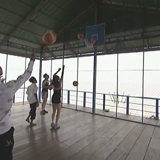Terence &amp; Sarah play basketball as part of the <i>Village Life</i> Detour on <a href=