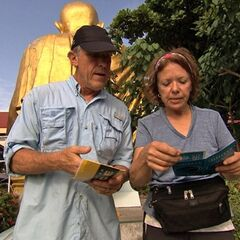 Bill & Cathi reading their clue in Leg 5.
