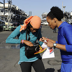 Kisha & Jen reading the clue for the first Roadblock on Leg 12.