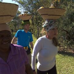 Denise &amp; James Earl carrying fruit baskets on their heads in <a href=