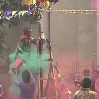 Terence is bombarded by dyes at the Holi festival Roadblock on <a href=