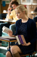 Gwen sits at her desk
