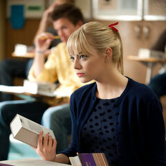 Gwen sits at her desk at Midtown High.