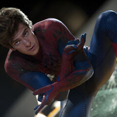 Peter, maskless, in his Spider-Man suit.