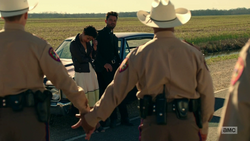 Jesse commands two state troopers to hold hands