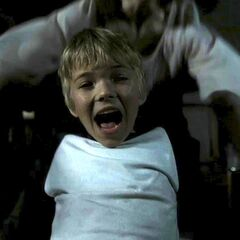 Flashback: Tate goes down to the basement where he meets the Infantata and Nora, who comforts him