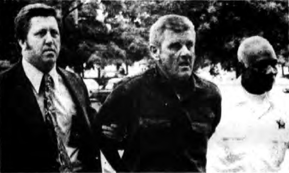 File:William Workman escorted by police.jpg
