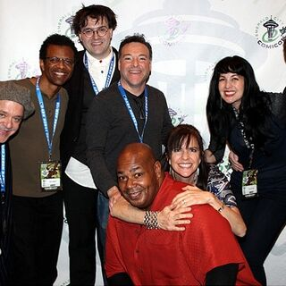 Quinton with Jim Cummings, Phil LaMarr, Rikki Simons, Richard Horvitz, Kevin Michael Richardson, Jennifer Hale, and Grey DeLisle Griffin at the 2013 Emerald City Comicon.