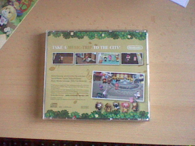 File:K.K Back of CD Case.jpg