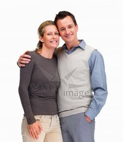 182276-Smiling-mature-man-and-woman-standing-together