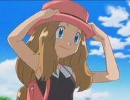 Serena holding her hat