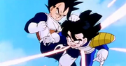 Vegeta grabed gohan by the hair and knees him in the stomach2