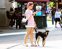 File:Ariana takes Coco out for a walk.jpg