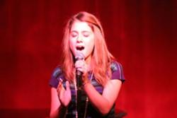 File:Ariana singing.jpg