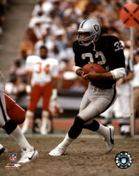 AAGQ220~Marcus-Allen-Black-Uniform-With-Ball-Posters