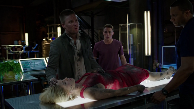 File:Oliver brings Felicity to the Arrowcave after Werner Zytle's attack.png