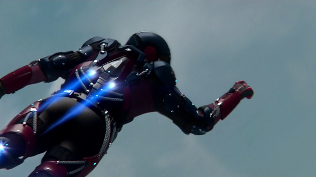 File:The back of the A.T.O.M. Exosuit during flight.png