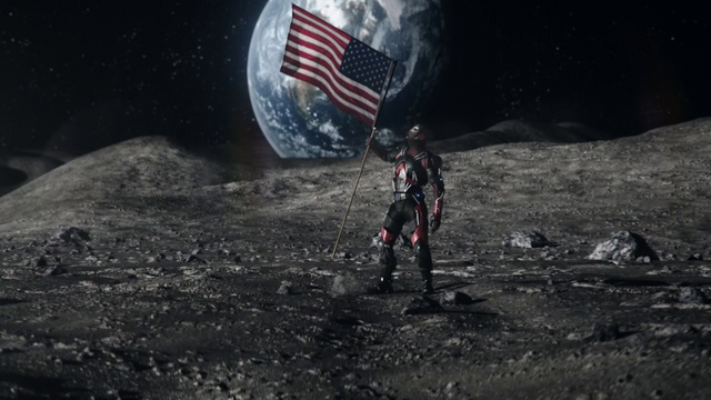 File:Ray Palmer retrieves the last fragment of the Spear from the US flag on the moon.png