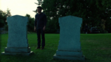 Oliver visits his father's grave