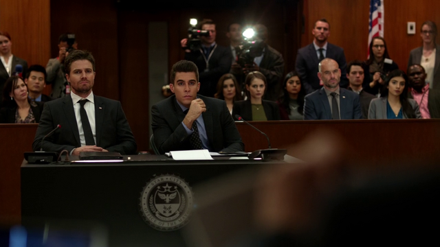 File:Oliver Queen at his impeachment hearing.png