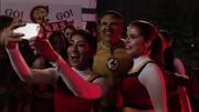 Kid Flash with cheerleaders.png