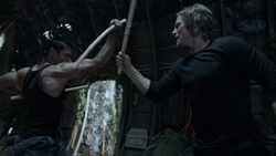 Oliver improves his fighting skills with Slade.png