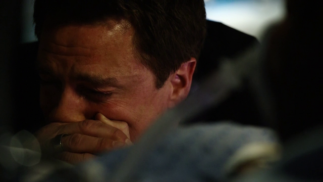 File:Malcolm cries over Thea who is on life support.png