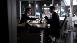 Harrison Wells and Hartley Rathaway playing a game of chess