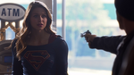 Supergirl talking the armed robber out of robbing a convenience store