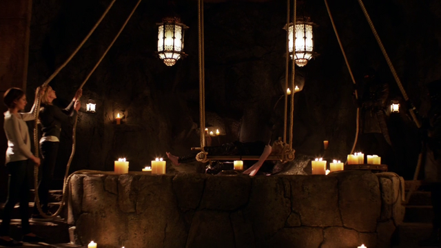 File:Sara Lance's corpse being lowered in to the Lazarus Pit.png