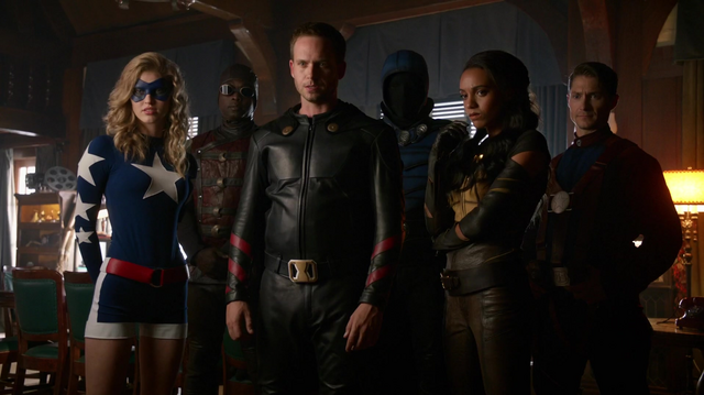 File:The Justice Society of America watch the imprisoned Legends on security footage.png